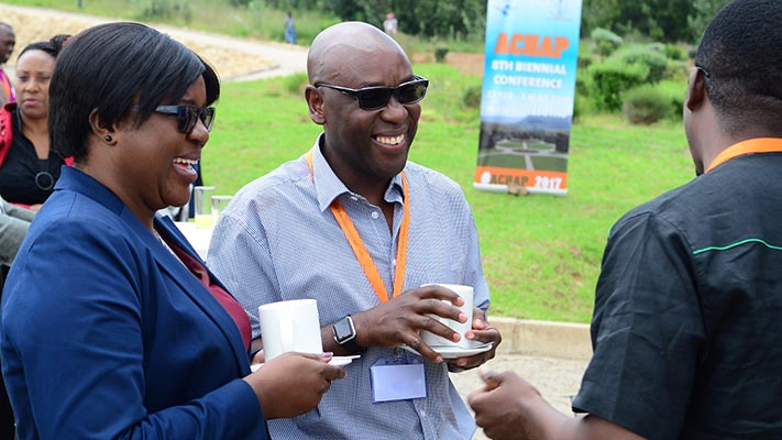 Attendees chat during the 8th Biennial Conference in Maseru, Lesotho in 2017.